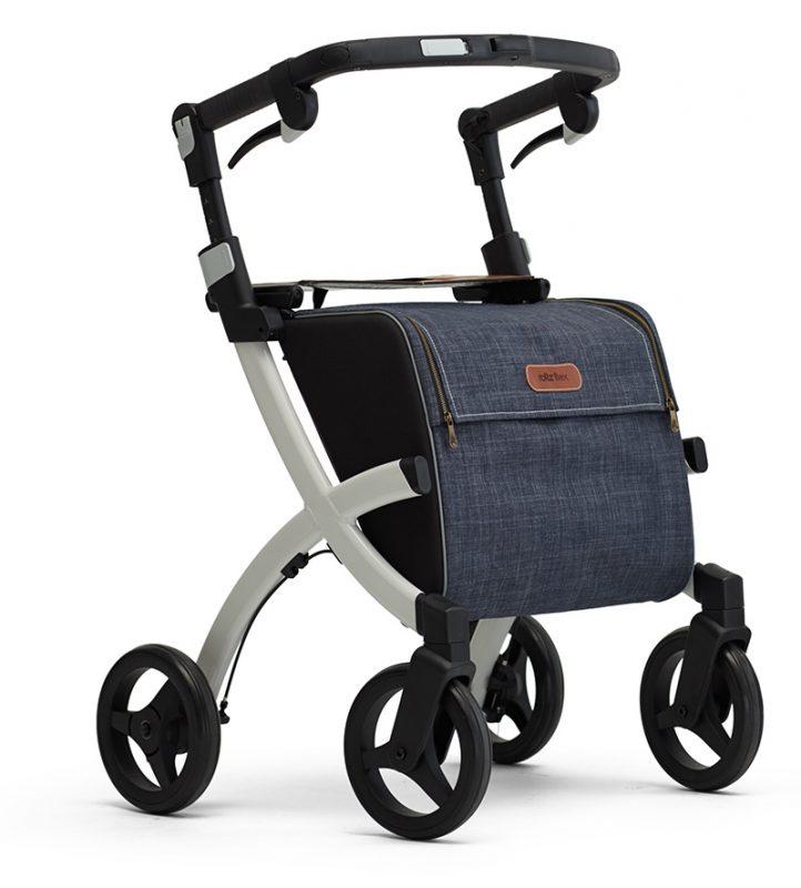 Rollz Flex Andador y Carro de la Compra de 4 ruedas grandes de 3 radios, con asiento, manillar, frenos y con marco de color blanco y con un gran bolso de color azul vaquero